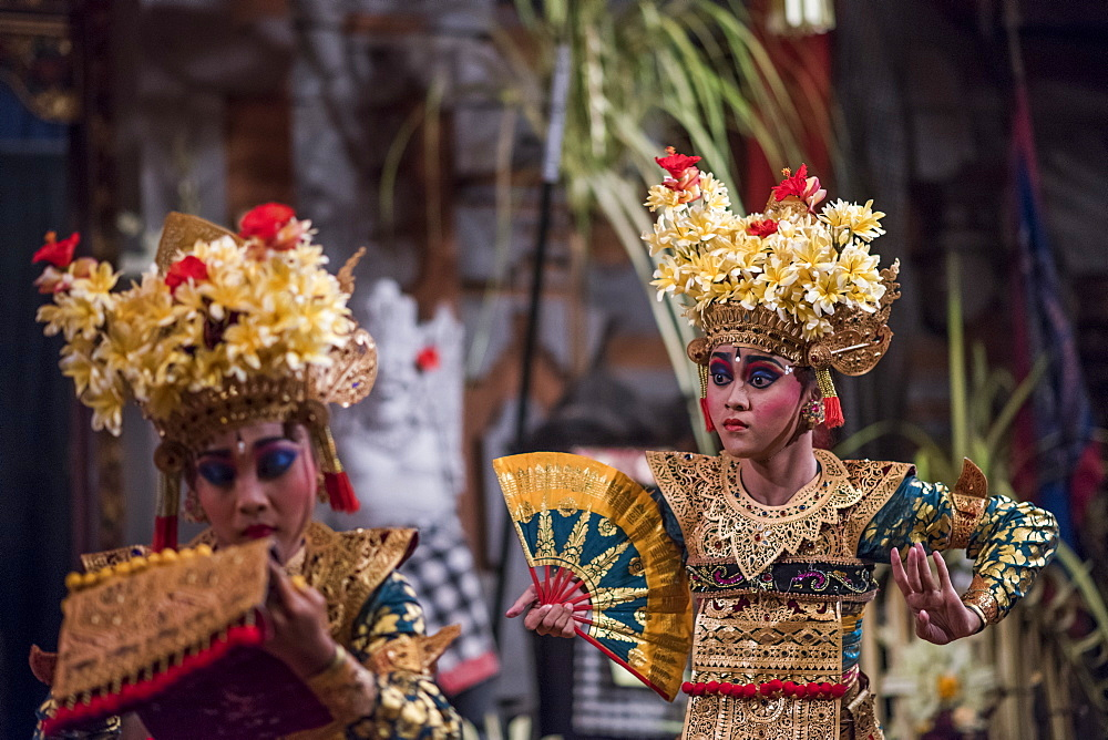 Traditional Balinese Legong Dancers Performing In A Theater In Ubud, Bali, Indonesia