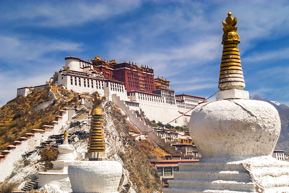 Chortens Sit Atop Chokpo Ri In Front Of The Potala Palace, Lhasa, Tibet