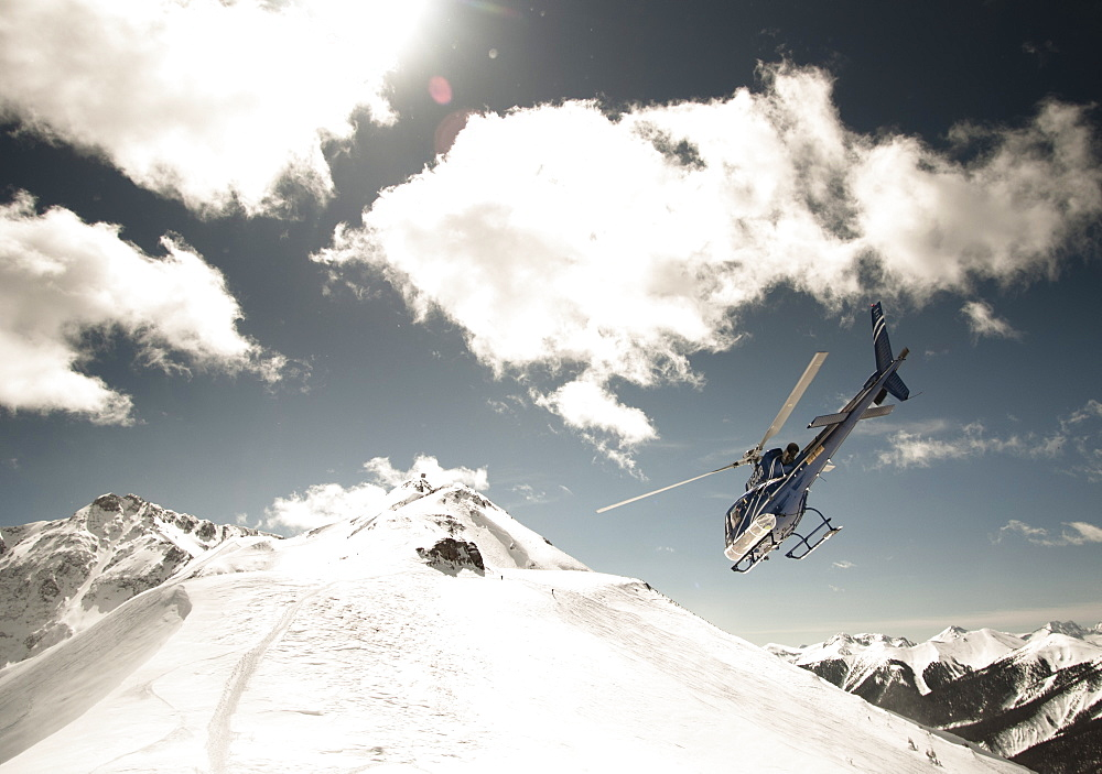 Helicopter Flying Over Silverton Mountain Ski Resort