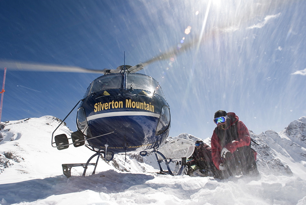 A Helicopter Taking Off After Dropping A Snowboarders In The San Juan Mountain Range