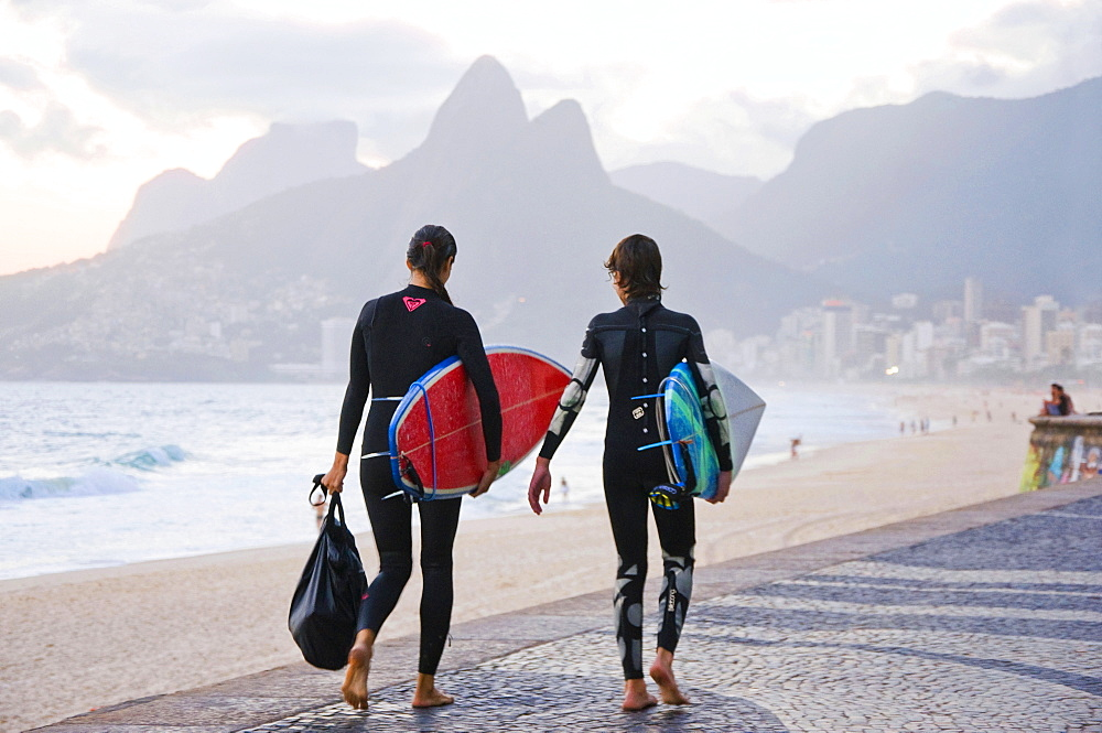 Female Surfers Walking On Arpoador Beach In Rio De Janeiro, Brazil
