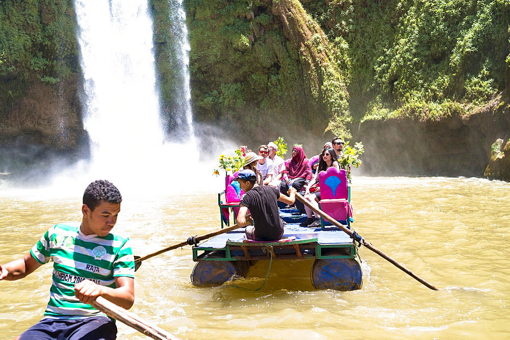 Boats Carry Tourists At The Cascades Douzoud Waterfall In The Atlas Mountains