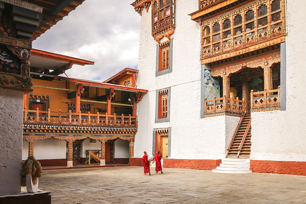 Two Monks Walking In The Temple Of Punakha Dzong, Bhutan