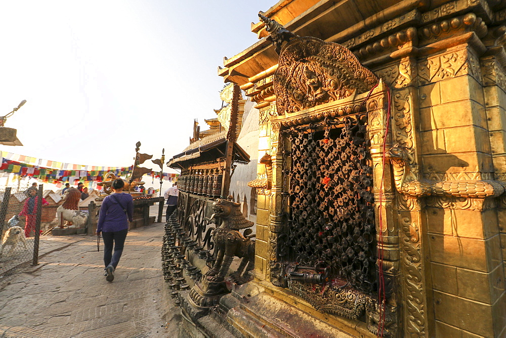 A Woman Completes Her Circumnavigation Of Swayambhunath Stupa In Early Morning Light