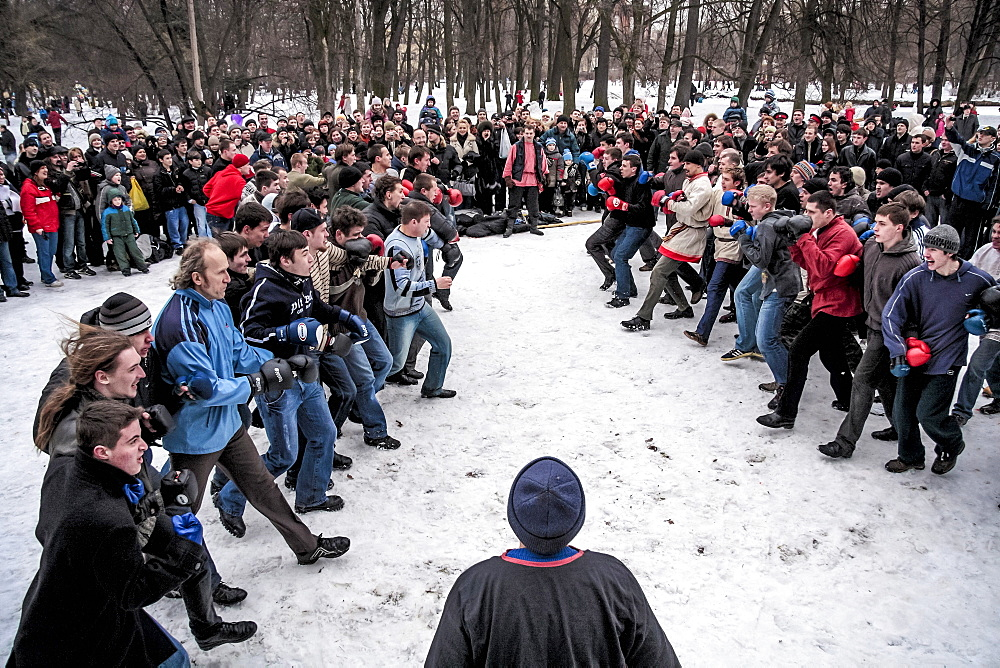 Tourist Watching Fighters Brawl At The Festival Of Maslenitsa