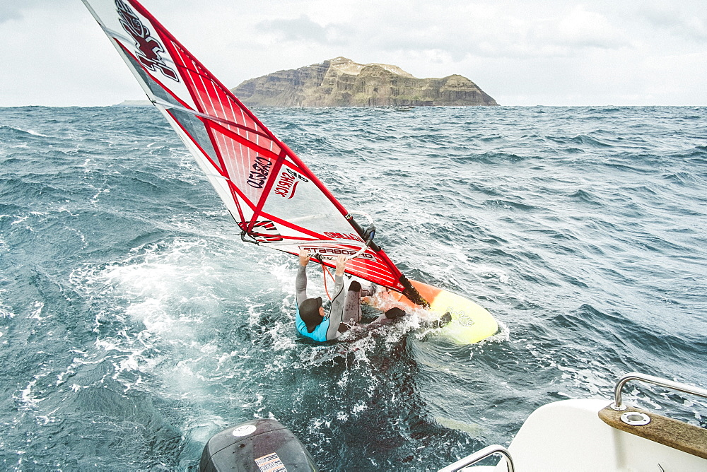 Man Windsurfing On Sea At Faroe Islands