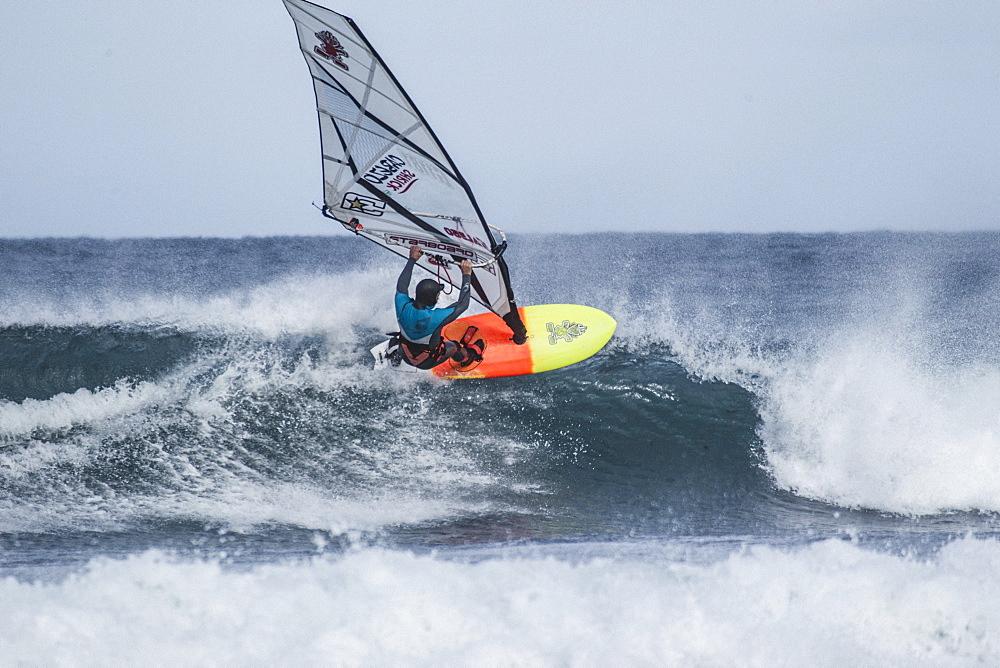 Professional Windsurfer On The Freezing Waters Of The Faroe Islands