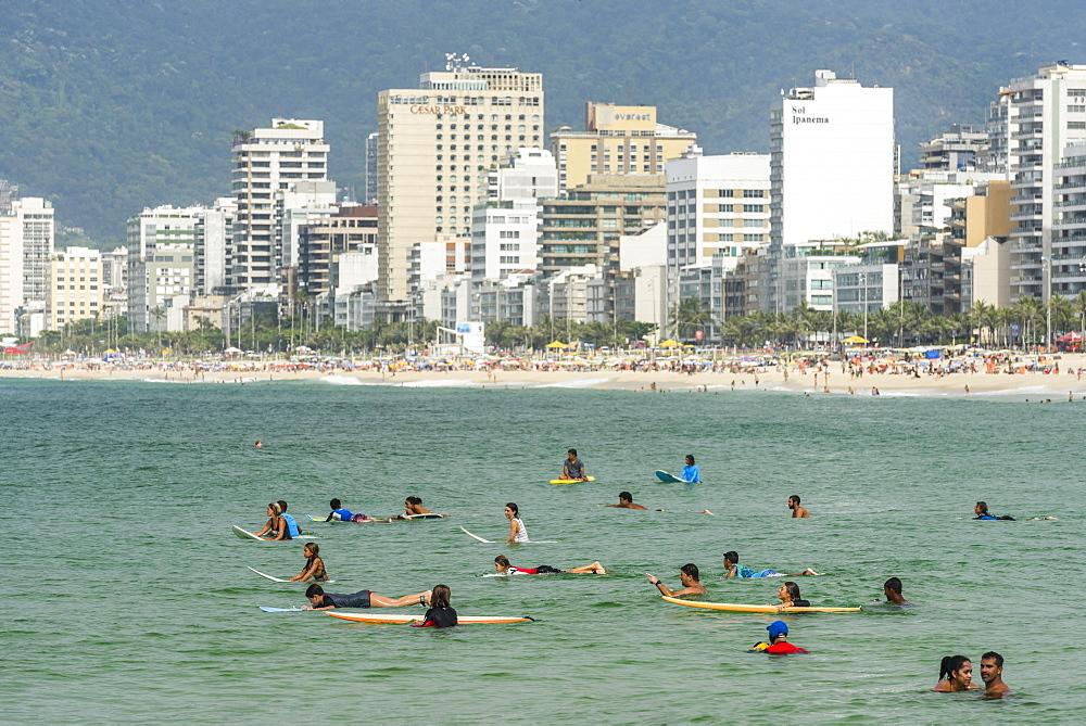 Surfers In Ipanema Beach, Rio De Janeiro, Brazil