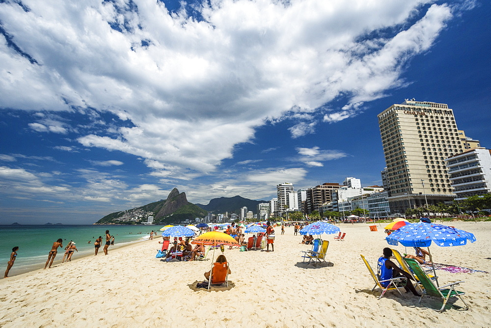 Umbrellas in a sunny Ipanema Beach, south zone of Rio de Janeiro, Brazil