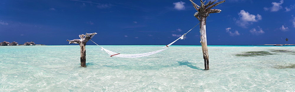 Hammock hanging above sea at Gili Lankanfushi island