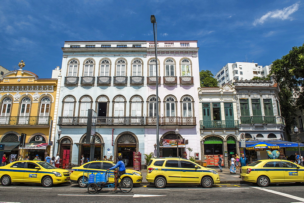 Old historical houses and Iconic yellow taxi in Rua do Catete street, Rio de Janeiro, Brazil