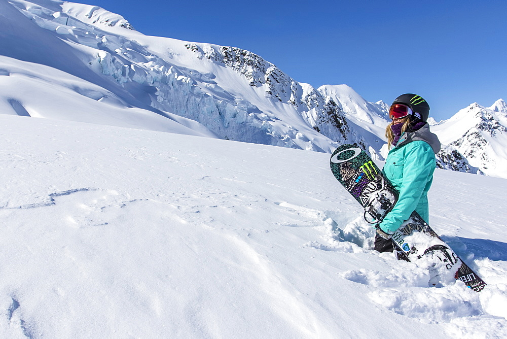 Professional Snowboarder and 2014 Olympic Gold Medalist, Jamie Anderson enjoys the mountains on a sunny bluebird day in Haines, Alaska.