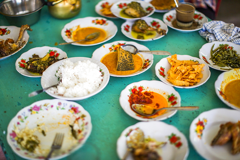 Traditional food, padang, at a restaurant in Kerinci Valley, Indonesia. - 857-94736