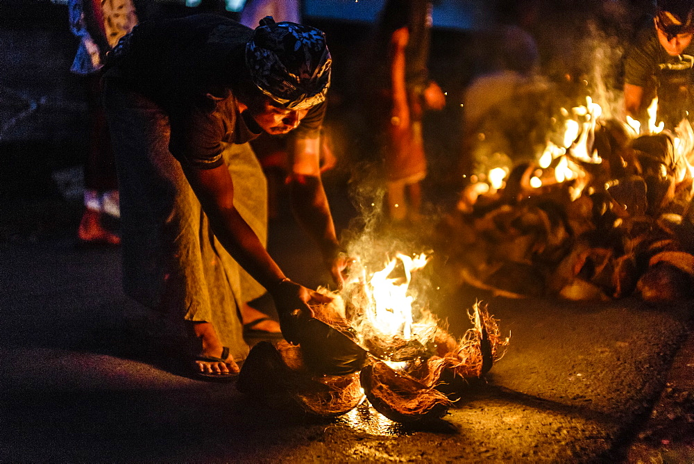 Person burning coconut husks at night, Tabanan, Bali, Indonesia - 857-94745