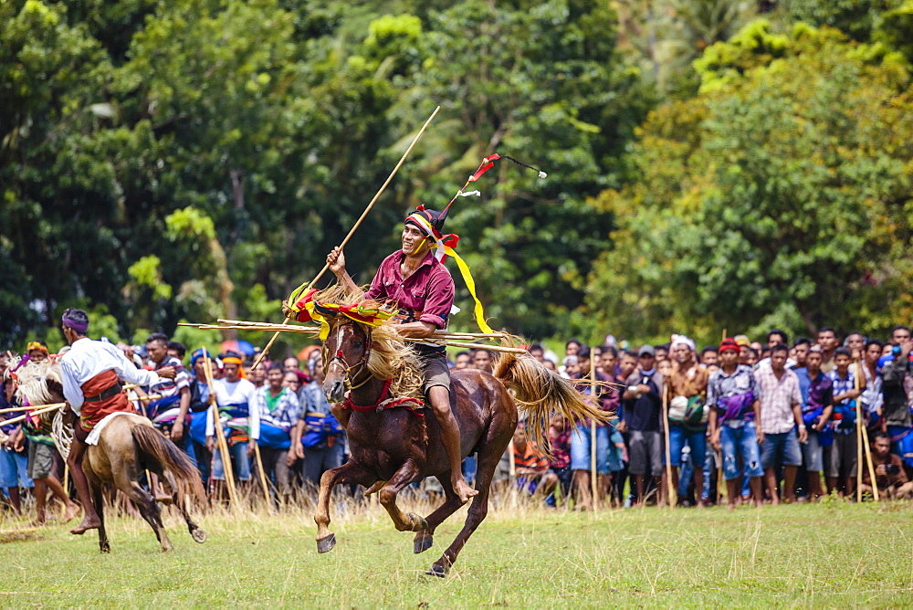 Men on horses competing in Pasola Festival, Sumba island, Indonesia