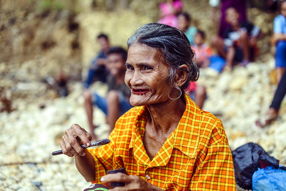 Portrait of senior woman eating betel nut, Sumba Island, Indonesia