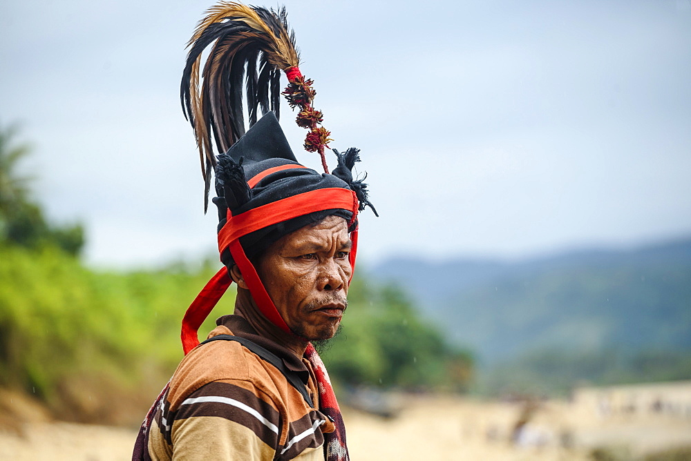 Man wearing hat and traditional costume, Pasola festival, Sumba Island, Indonesia