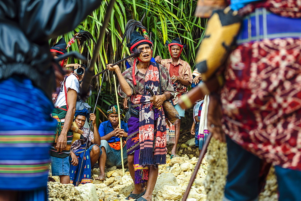 Man with spear participating in ceremony before Pasola festival, Sumba Island, Indonesia