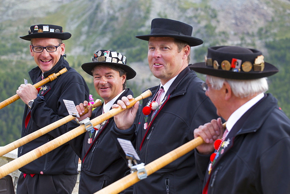 Four traditionally dressed locals with alphorns, Zermatt, Valais, Switzerland - 857-94849