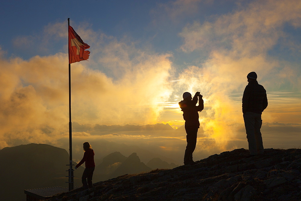 Family of hikers at summit of Faulhorn in Swiss Alps at sunset, Grindelwald, Bernese Oberland, Bern Canton, Switzerland