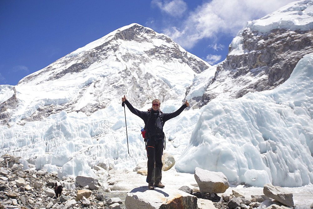 Happy male hiker with his hands in air in Everest Base Camp, Khumbu, Nepal