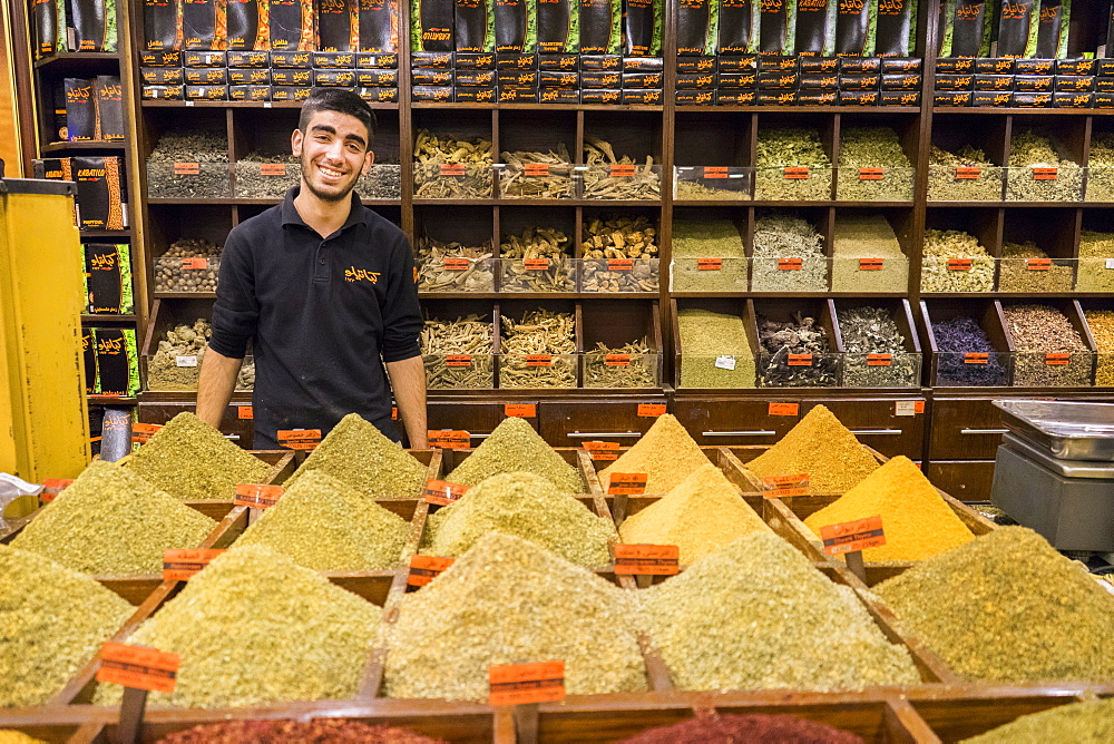 A man sells spices, herbs, nuts and Egyptian duqqa in a Spice Market in Amman, Jordan