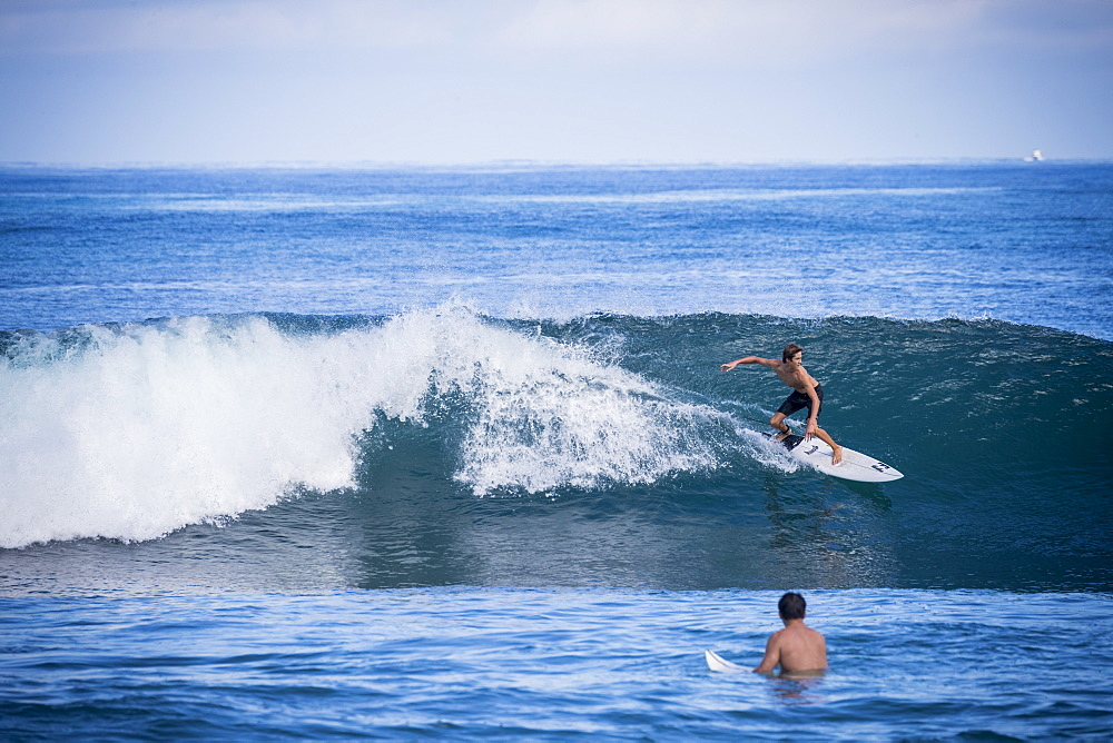 Full length shot of young man surfing in sea