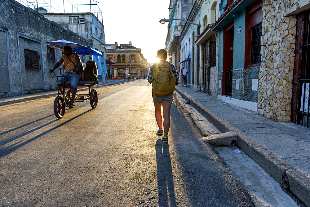 Rear view of female tourist walking in street of Havana, Cuba