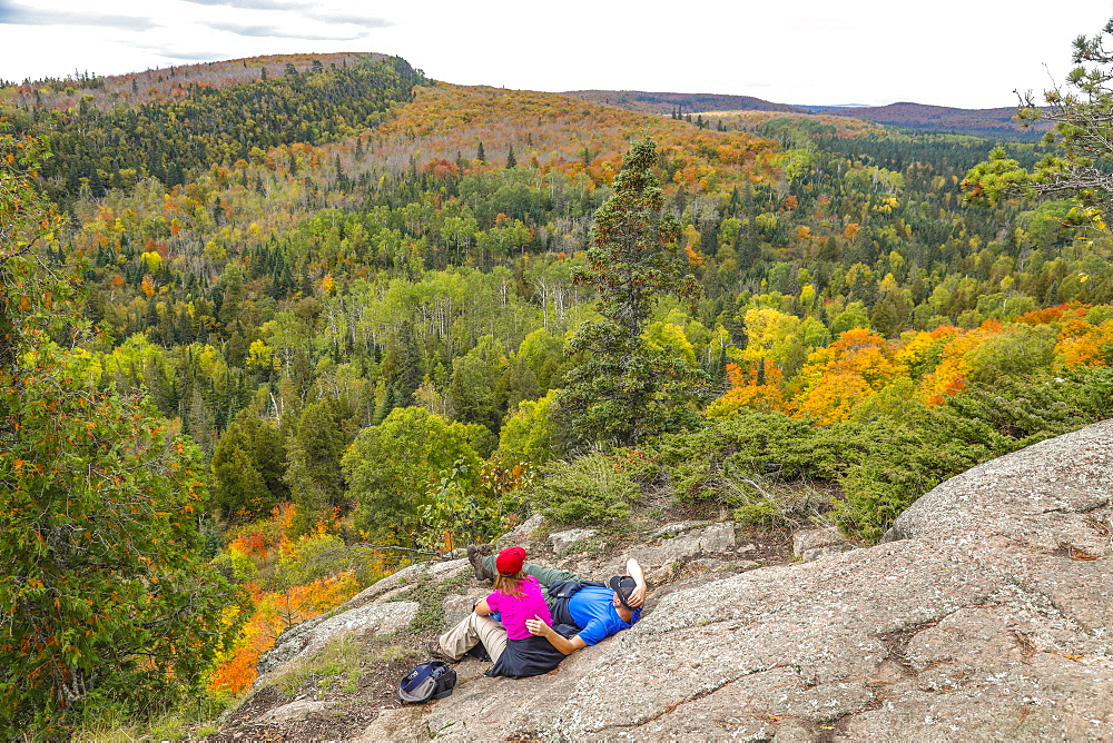 Scenery with forest and hikers at Oberg Mountain hiking trail, Tofte, Minnesota, USA - 857-95514