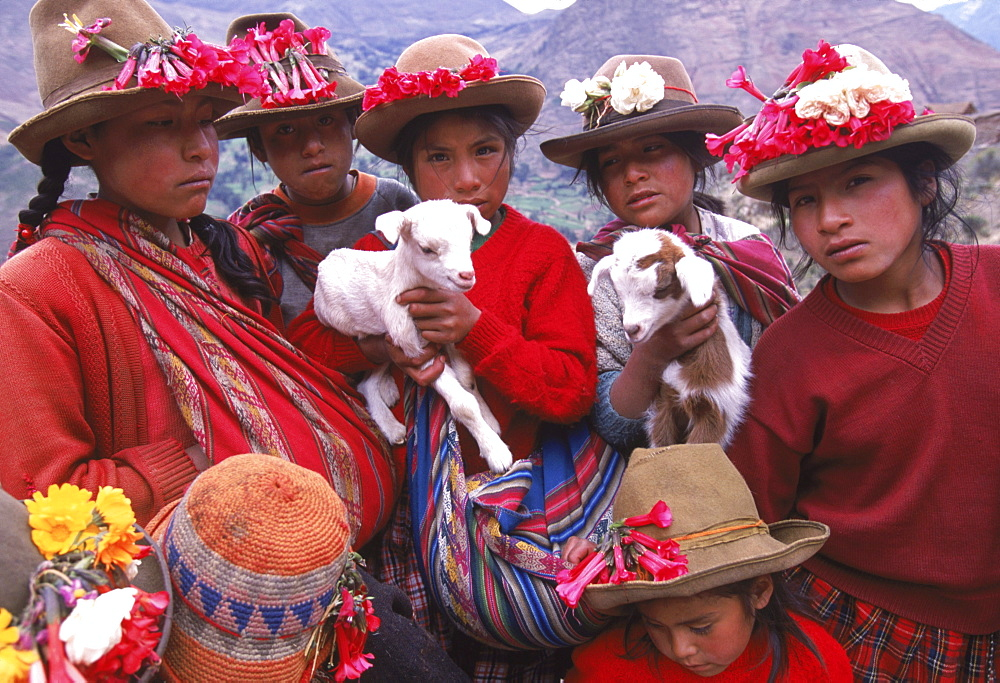 Quechua girls and families sell their crafts in the ruins above the small village of Pisac near Cusco. - 857-9552