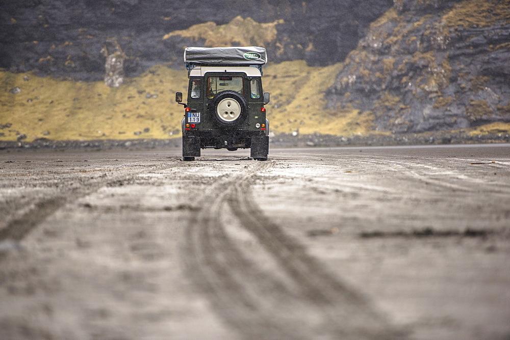 Rear view of 4x4 car in natural setting, Faroe Islands, Denmark
