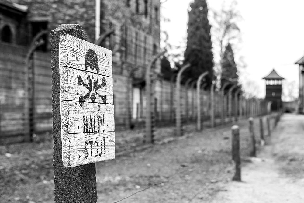 A skull and cross bones sign signaling to stop at the Auschwitz concentration camp in Oswiecim, Malopolskie Province, Poland