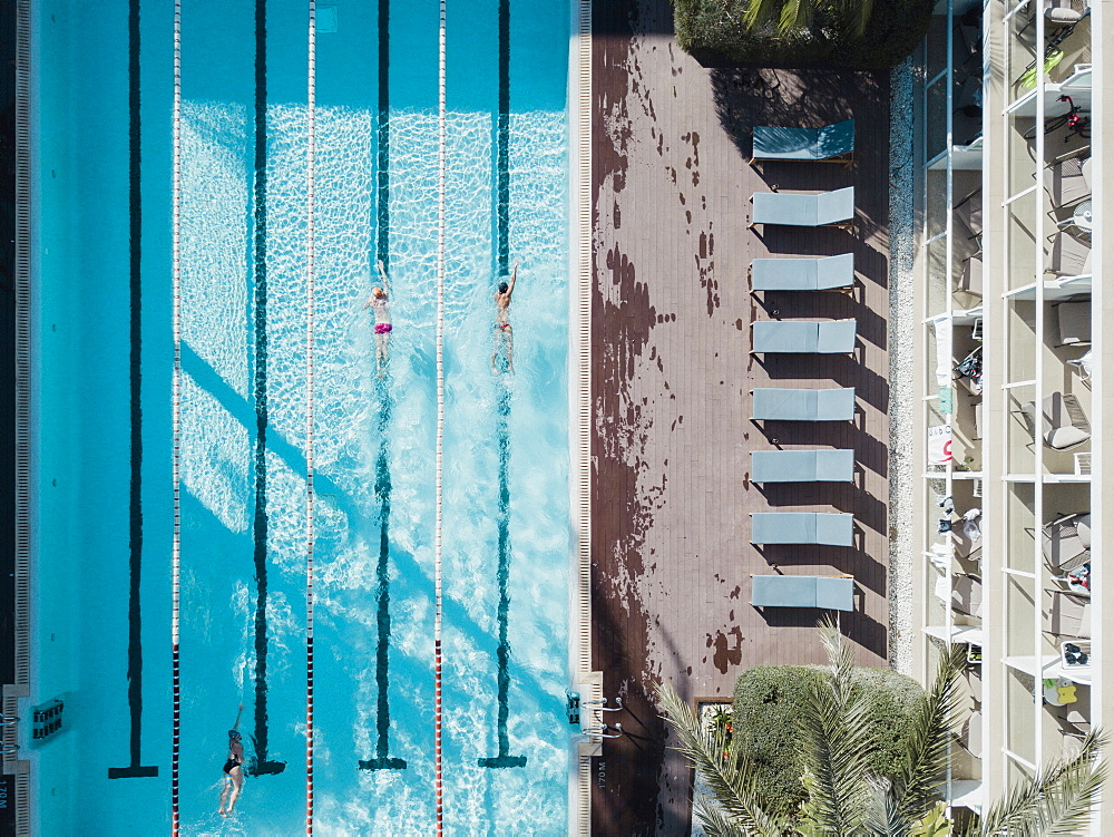 Aerial view of swimmers in hotel swimming pool, Mallorca, Balearic Islands, Spain