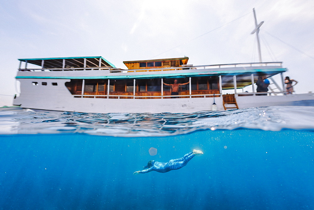 Freediving under a boat, Komodo, Nusa Tenggara Timur, Indonesia - 857-95577