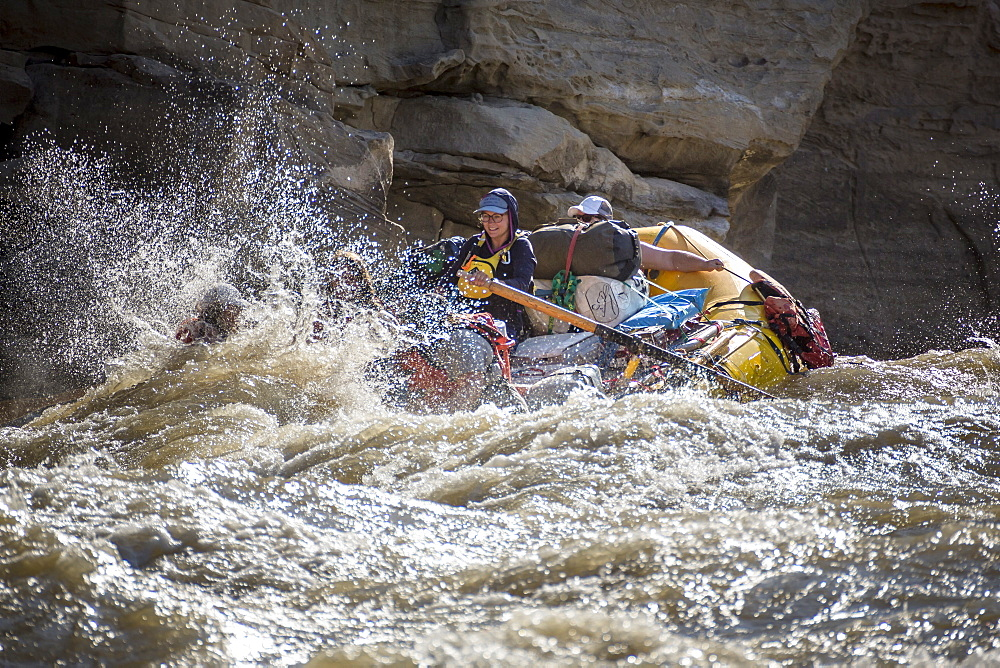 Men and women rafting on rushing Green River in Desolation Canyon, Utah, USA