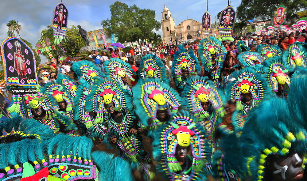 Large group of people in tribal costumes at Ati Atihan festival, Kalibo, Aklan, Panay Island, Philippines