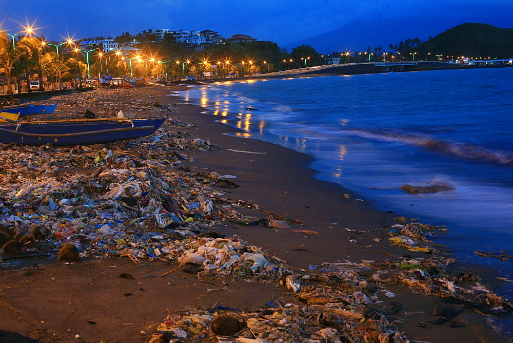 Polluted beach with trash at night, Legazpi City, Albay Province, Philippines