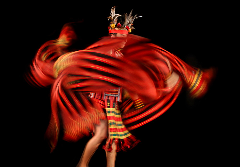 Ifugao tribesman dancing against black background, Banaue, Ifugao, Philippines