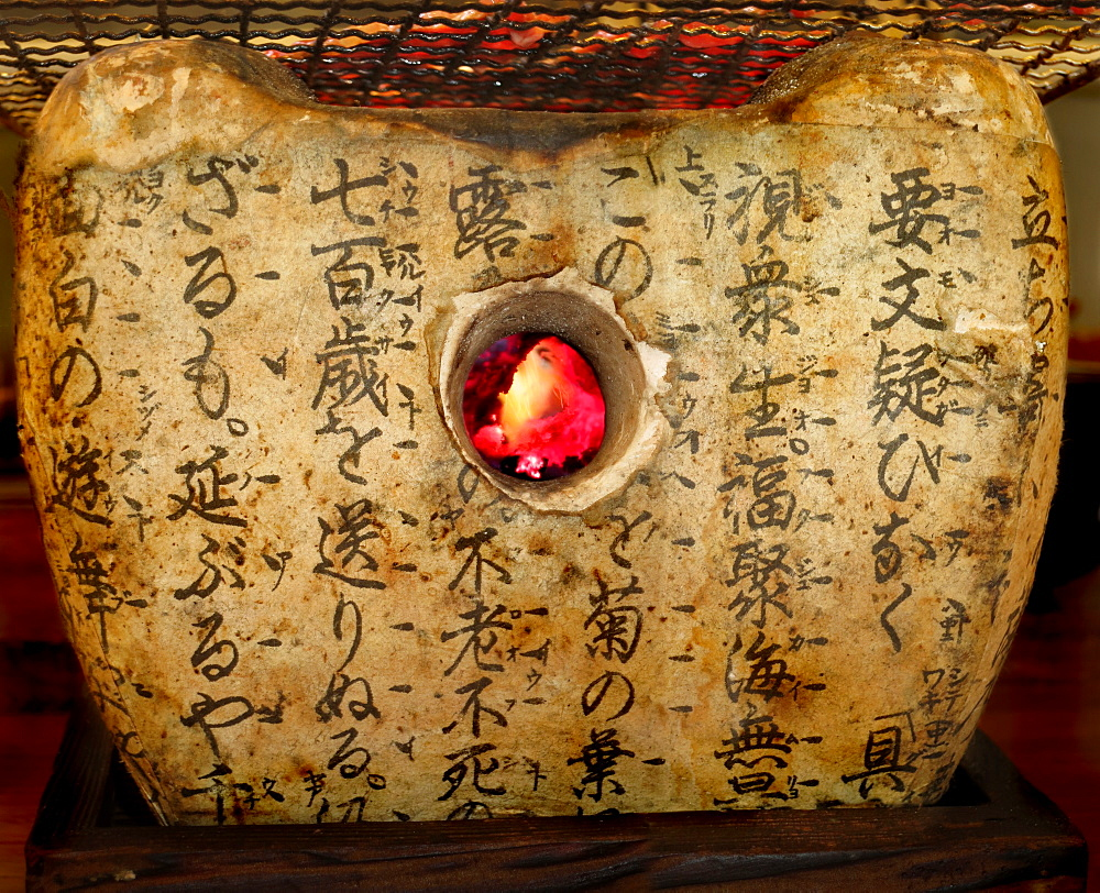 Steak on stone oven with inscriptions in Japanese restaurant, Tokyo, Japan