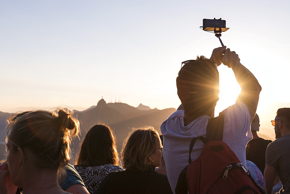 Rear view of group of tourists on Sugarloaf Mountain, Rio de Janeiro, Brazil