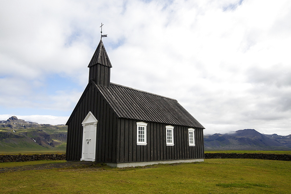 The?Budakirkja, commonly known as?Iceland's?Black Church, is a landmark in the town of?Budir?on the?Snaeffelsnes?Peninsula, Iceland - 857-95990
