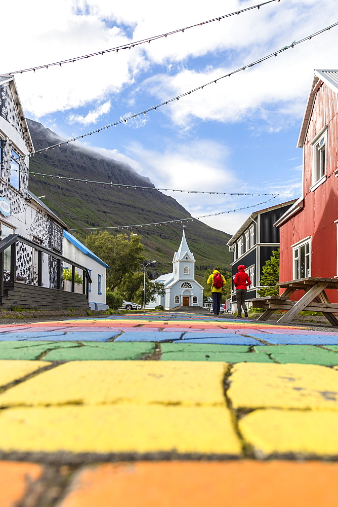 The main walking street of Seydisfjordur is painted in bright colors of the rainbow, Iceland