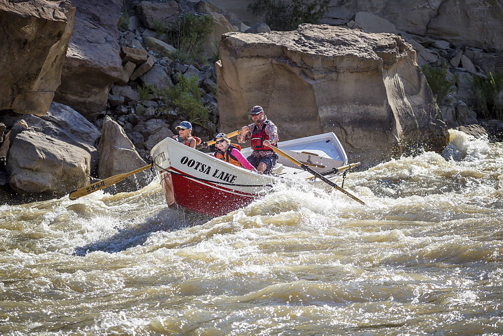 A Dory boat going through rapids in the?Desolation/Gray?Canyon section of the Green river, Utah, USA - 857-96066