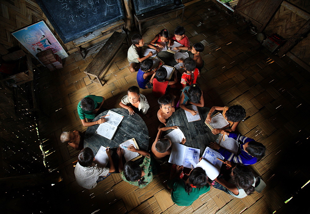 Children are study at morning in the orphanage cum primary school, Bandarban, Bangladesh