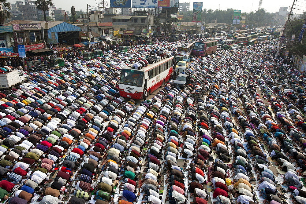 Muslims are praying at in the road due to large number Muslims gathered at  Bishaw ijtema at Tongi, Bangladesh