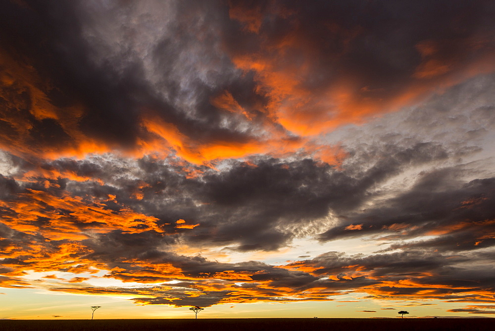 Kenya, Masai-Mara game reserve, clouds at sunrise