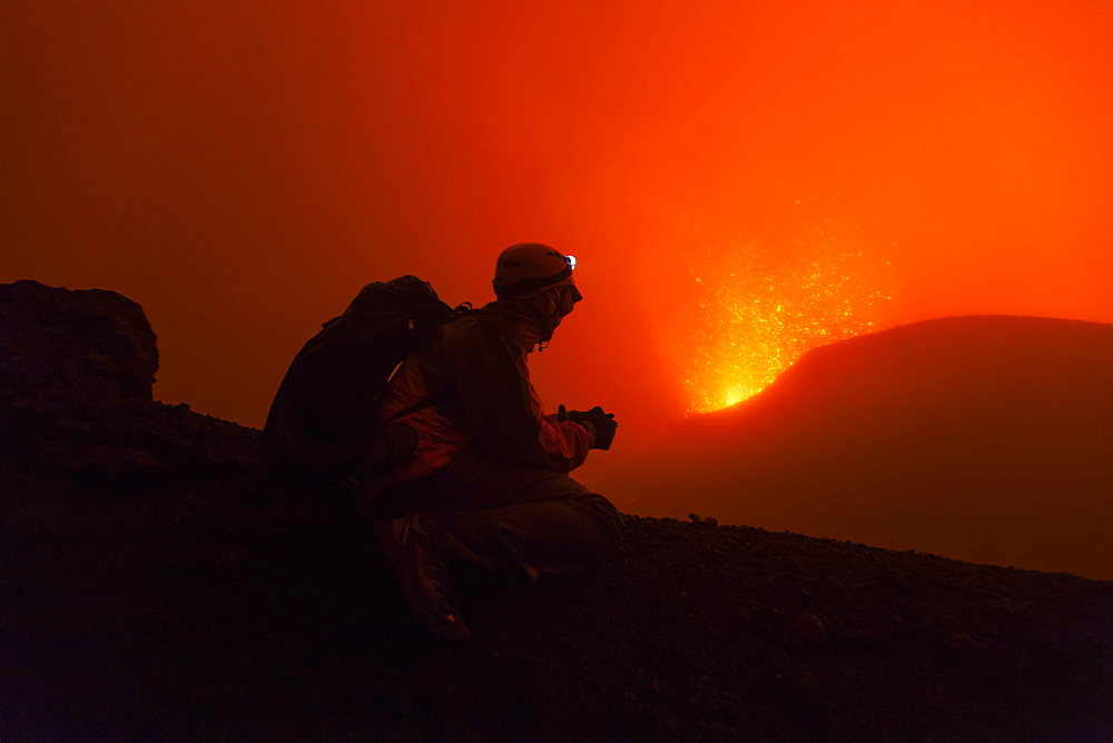 Volcanologist on Piton de la Fournaise in activity, Volcano eruption of May 2015, Reunion - 860-286840