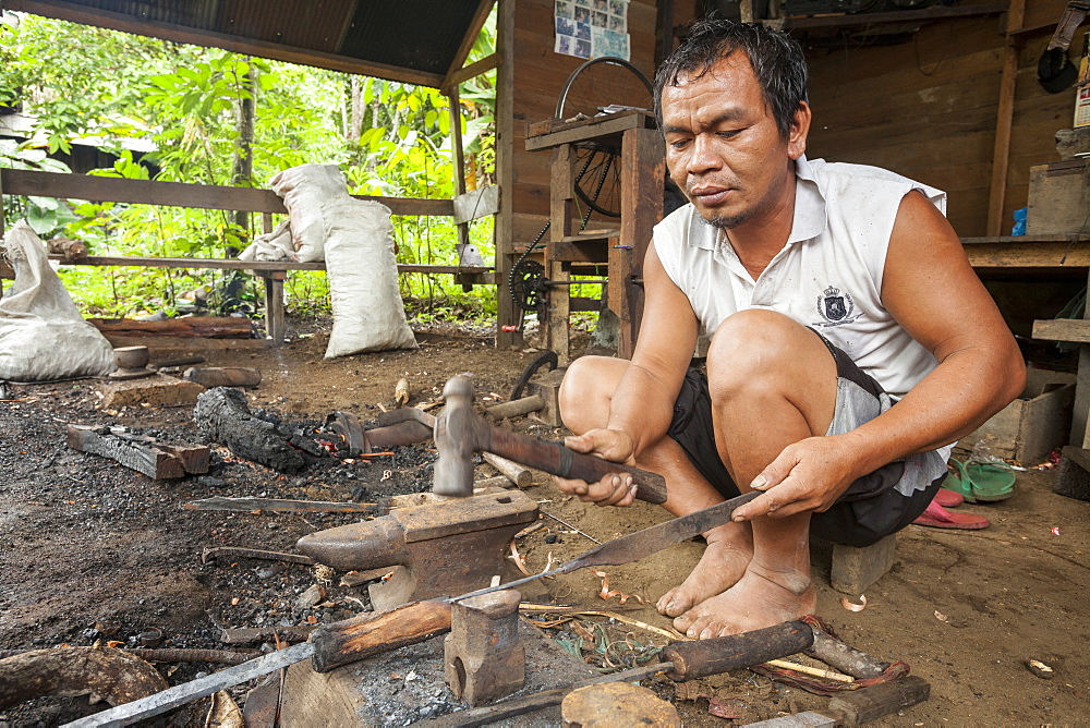Man forging a traditional Dayak saber - Borneo Indonesia