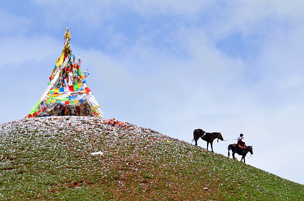 Rider and stupa at the Lapst? - Tibet China