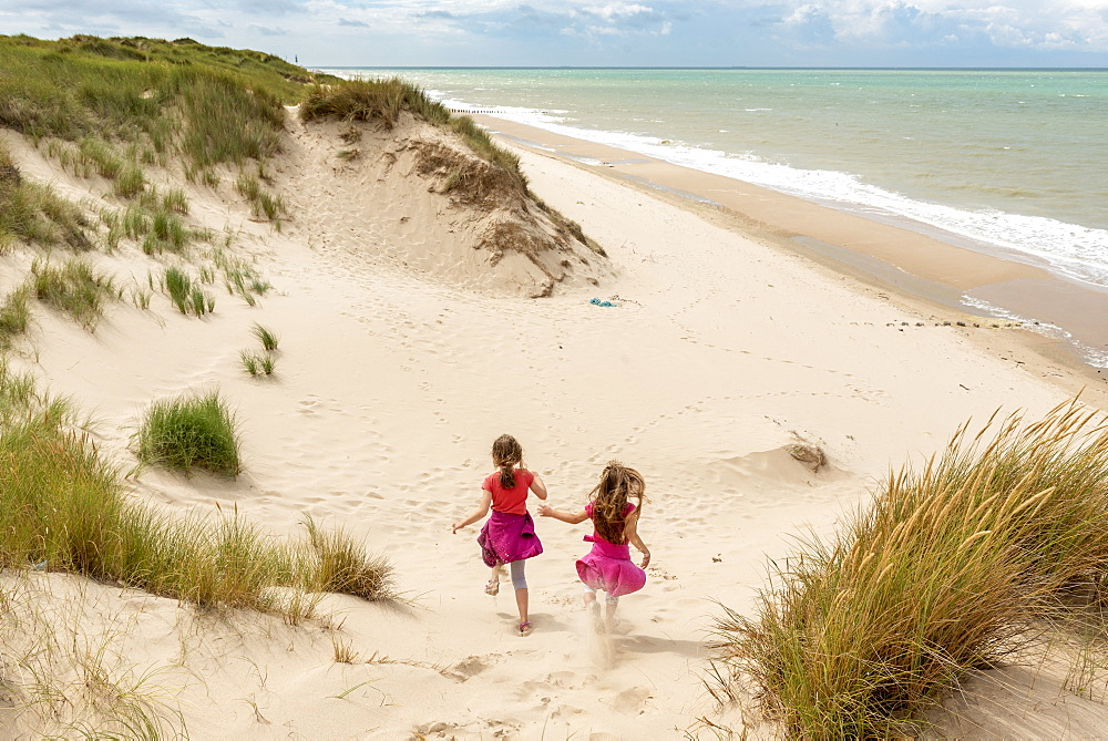 Little girls running in the dunes of the Opal Coast, summer, Pas de Calais, France